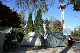 "Since the ""Jungle"" homeless encampment has been emptied of its 300-400 residents, smaller encampments have sprung up around the city, including this one at the corner of Denny Way and Broad Street. Photographed Oct. 12, 2016."