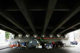 """A small tent encampment is seen under the Ballard Bridge. Since the """"Jungle"""" homeless encampment has been emptied of its 300-400 residents, smaller encampments have sprung up around the city. Photographed Oct. 12, 2016."""
