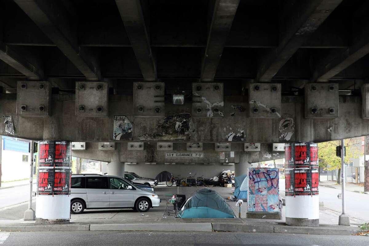 A small tent encampment is seen under the Ballard Bridge. Since the