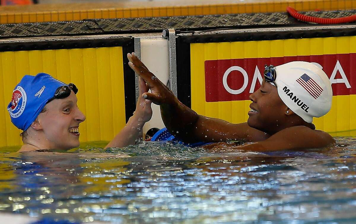 ATLANTA, GA - MAY 13: Katie Ledecky and Simone Manuel react after competing in the Women's 200 LC Meter Freestyle Finals during day one of the Atlanta Classic Swim Meet at Georgia Tech Aquatic Center on May 13, 2016 in Atlanta, Georgia. (Photo by Kevin C. Cox/Getty Images)