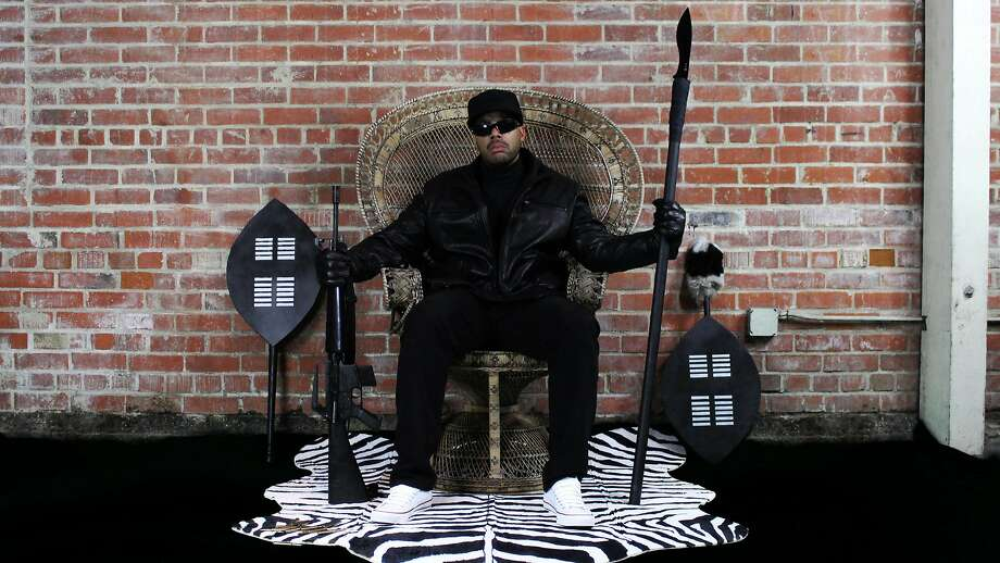 San Francisco-based rapper Paris re-creates the famous wicker chair photo the of Black Panthers co-founder Huey Newton. Photo: Guerrilla Funk