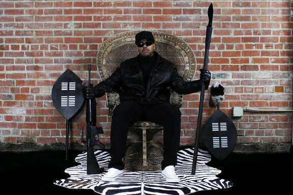 San Francisco-based rapper Paris re-creates the famous wicker chair photo the of Black Panthers co-founder Huey Newton.