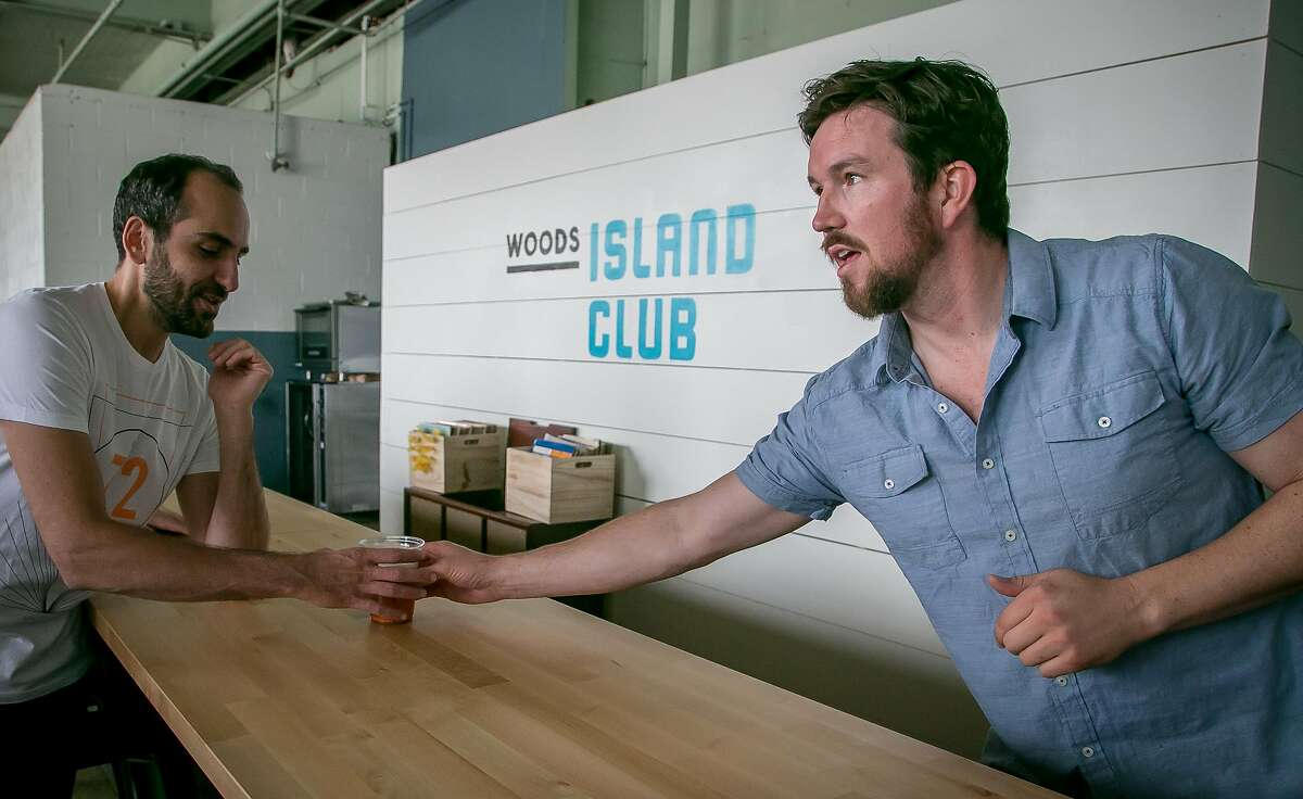 Jim Woods slides a beer to a customer at the Woods Island Club in San Francisco, Calif. on October 13th, 2016.