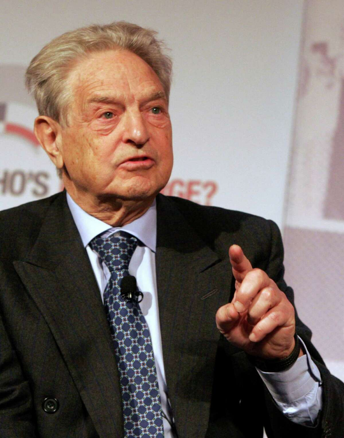 ** FILE ** In this Jan. 23, 2008 file photo, Chairman of the Soros Fund Management, USA, George Soros, pauses before speaking during a seminar at the World Economic Forum in Davos, Switzerland. A measure that would decriminalize minor marijuana-possession cases is on the ballot in Massachusetts largely because of Soros. Of the $429,000 collected last year by the group advancing the measure, $400,000 came from Soros, who has championed similar efforts in several states. (AP Photo/Virginia Mayo, File)