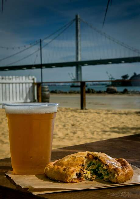 A Retro Pilsner with a beef empanada at Woods Island Club on Treasure Island. Photo: John Storey, Special To The Chronicle