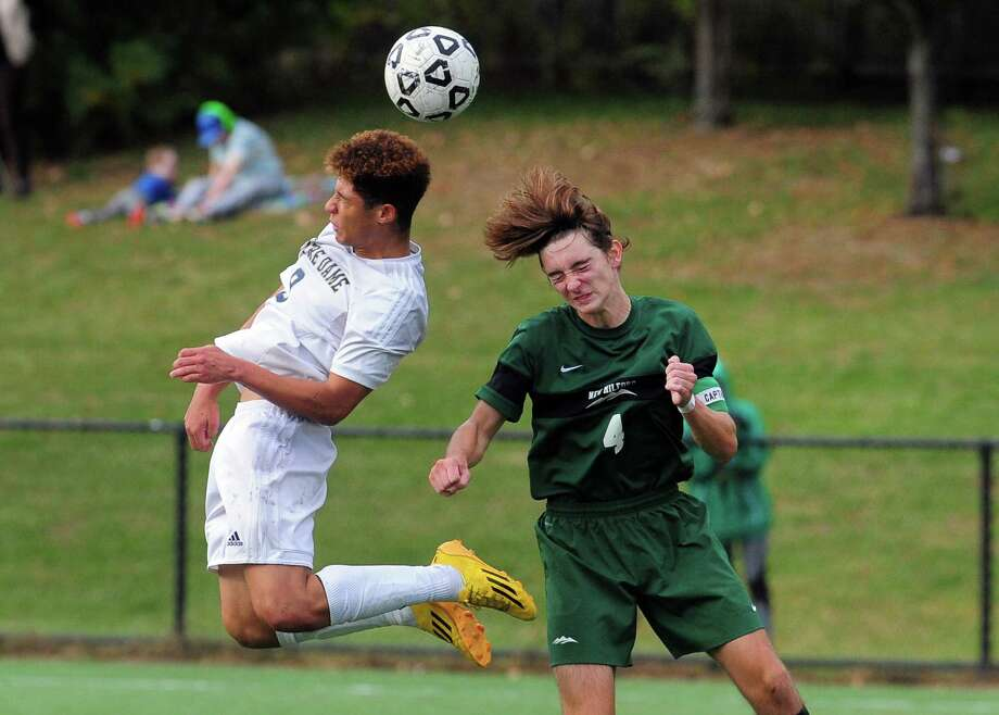 Notre Dame of Fairfield's Felipe Canzian, left, and New Milford's Christopher Agor leap to to head the ball during boys soccer action against Notre Dame of Fairfield in Fairfield, Conn., on Thursday Oct. 13, 2016. Photo: Christian Abraham / Hearst Connecticut Media / Connecticut Post