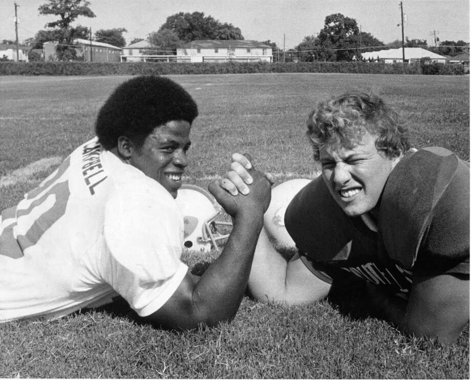 Earl Campbell, left, and Steve Freydenfeldt engage in some friendly arm wrestling before the 40th All-Star High School football game in 1974.   Photo: Ray Covey, HP Staff / Houston Post files