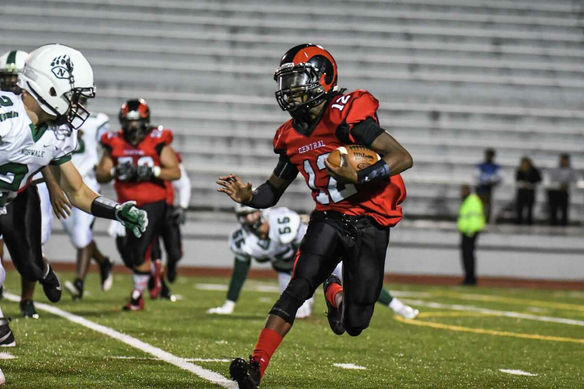 Navaughn Austin (12) of the Central Hilltoppers carries the ball during a game against the Norwalk Bears on October 13, 2016 at Central High School in Bridgeport, Connecticut.