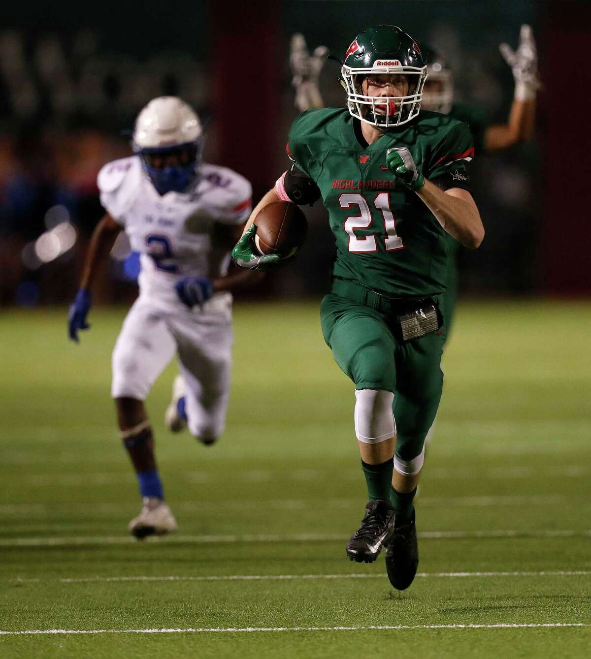 The Woodlands' outside linebacker Grant Milton (21) runs the ball in for the touchdown after intercepting a pass intended for Oak Ridge's wide receiver Darrius Jelks (2) during the first half of a District 12-6A high school football game between The Woodlands and Oak Ridge, Thursday, Oct. 13, 2016 in Shenandoah.
