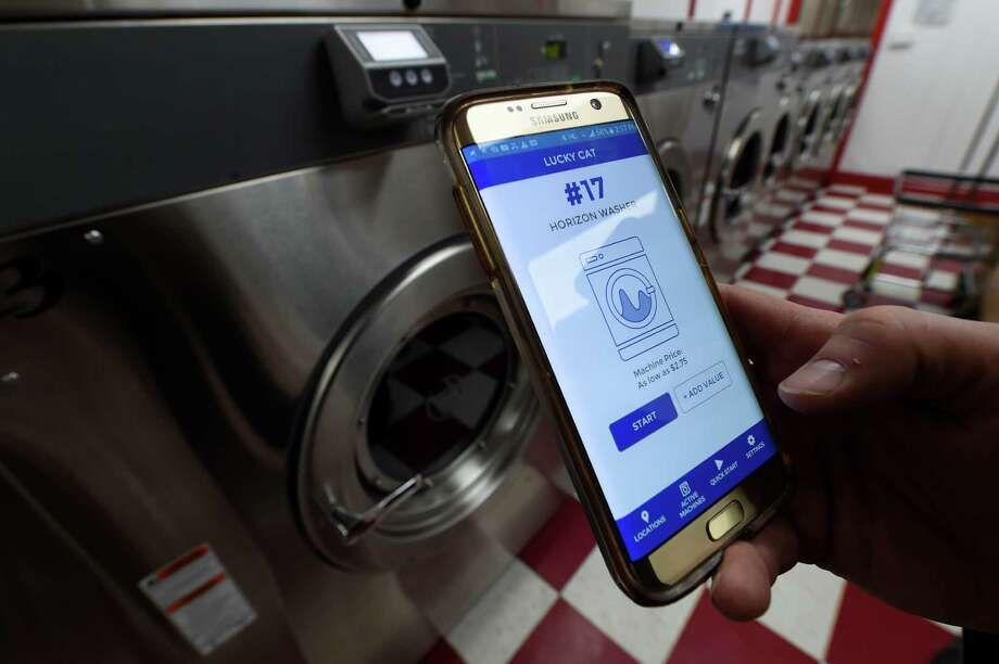 One of the techniques used in the brand new Lucky Cat Laundromat that was opened today is the washing machine app, which was inaugurated today Thursday 13 October 2016 in Albany, NY (Skip Dickstein / Times Union) Photo: SKIP DICKSTEIN / 20038394A