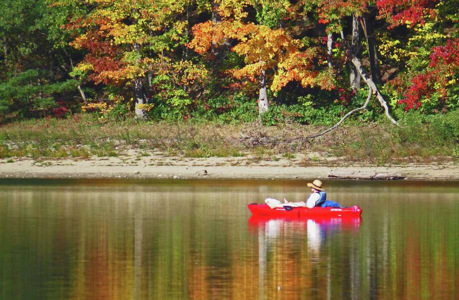 A kayaker on Moreau Lake takes advantage of the weather and leisurely paddles in the sunshine amid beautiful reflections of the foliage in the water in this photo taken by Bill Guarneri of Malta in 2016. New York will start to post its foliage map on line this week.