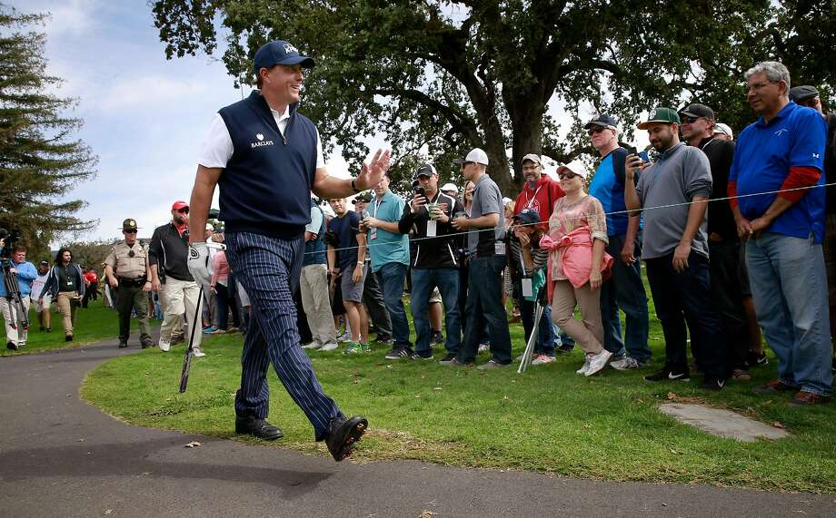 Phil Mickelson mingles with the gallery at Silverado during last year's Safeway Open. He has returned this year. Photo: Michael Macor, The Chronicle