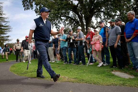 Phil Mickelson with a friendly wave to the gallery as he heads to the 3rd tee during the first round at the Safeway Open golf tournament at  the Silverado Resort in Napa, California, on Thursday October 13, 2016