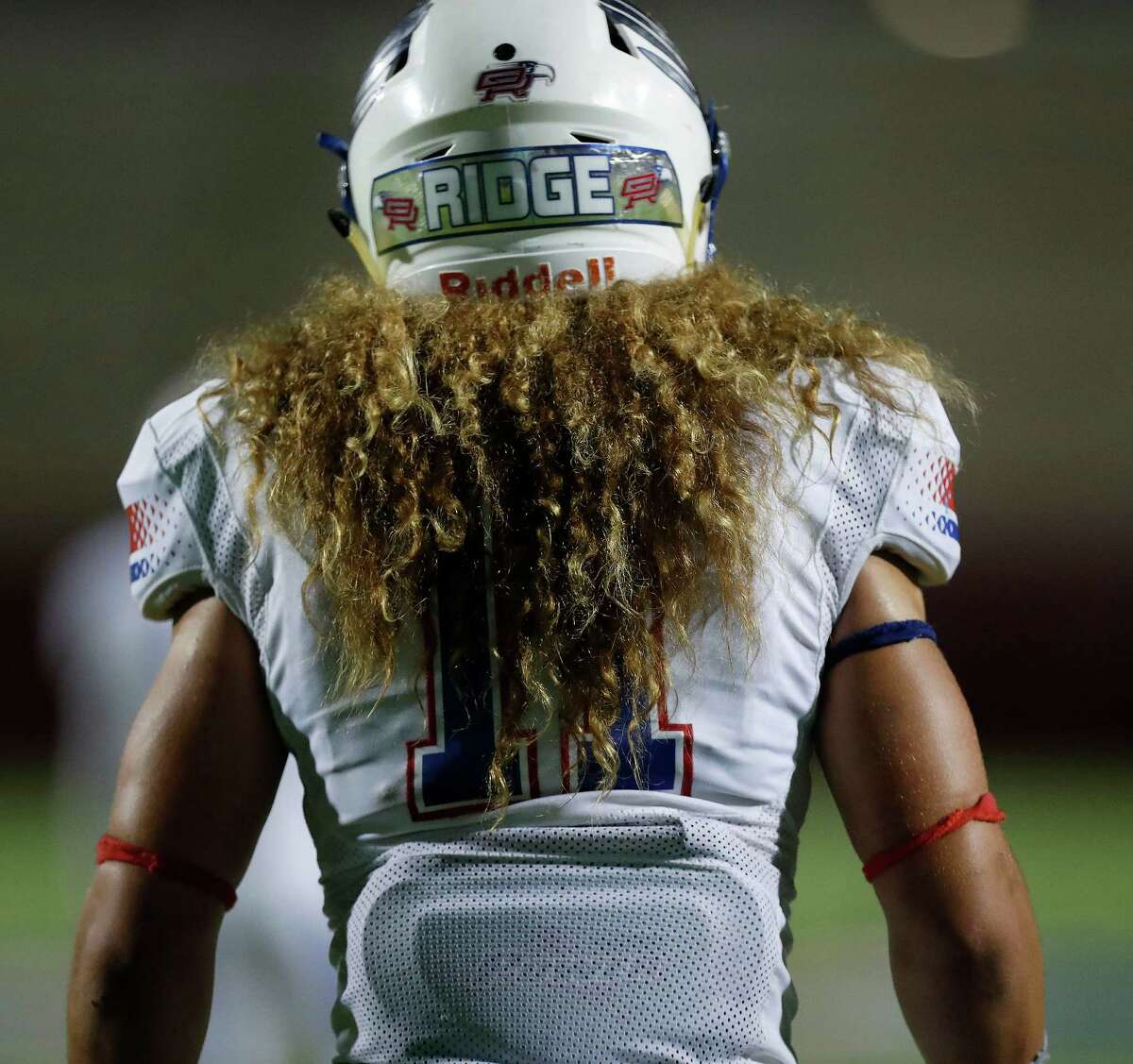 Oak Ridge's Grant Stuard's hair during the second half of a District 12-6A high school football game between The Woodlands and Oak Ridge, Thursday, Oct. 13, 2016 in Shenandoah.