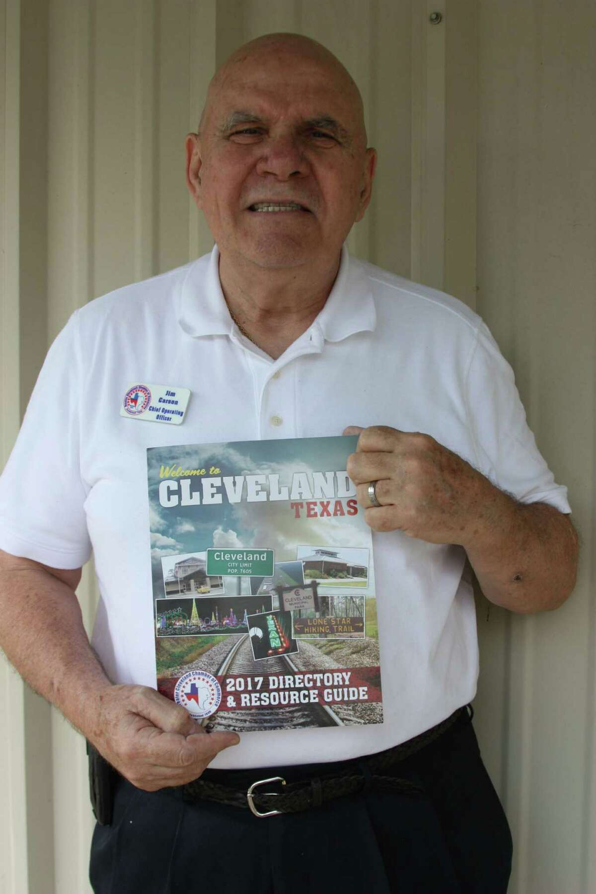 Greater Cleveland Chamber of Commerce Chief Operating Officer Jim Carson presents the new 2017 Directory and Resource Guide welcoming visitors to Cleveland. The Chamber has an estimated 3,000 copies made and placed in various businesses including local hotels, title companies, real estate agencies and banks.