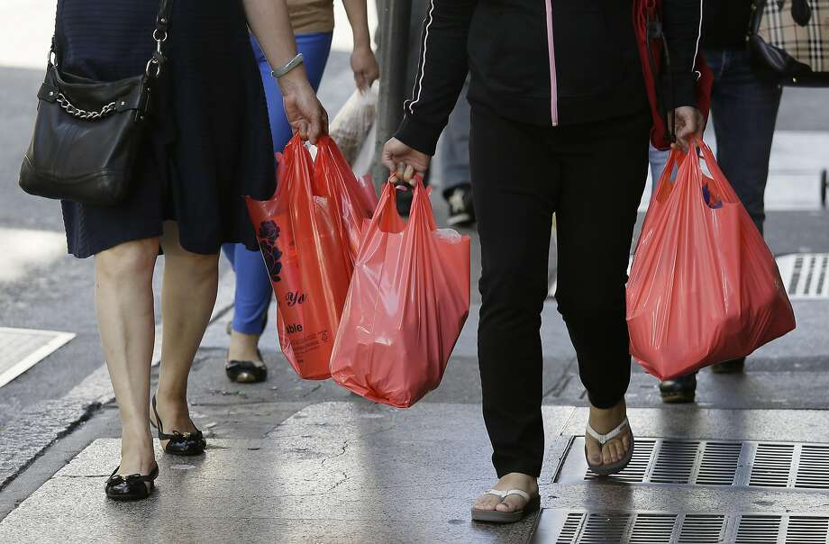 In this photo taken Tuesday, Sept. 20, 2016, women walk with plastic bags through Chinatown in San Francisco. California voters are considering a November referendum that would uphold or overturn a statewide ban on single-use plastic carryout bags. Photo: Eric Risberg, Associated Press