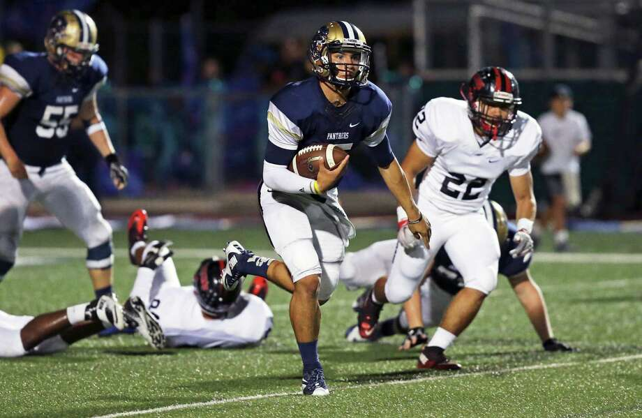 Panther quarterback Roel Sanchez takes it up the middle for a long first quarter gain as O'Connor plays Stevens at Farris Stadium on October 13, 2016. Photo: Tom Reel / San Antonio Express-News / 2016 SAN ANTONIO EXPRESS-NEWS
