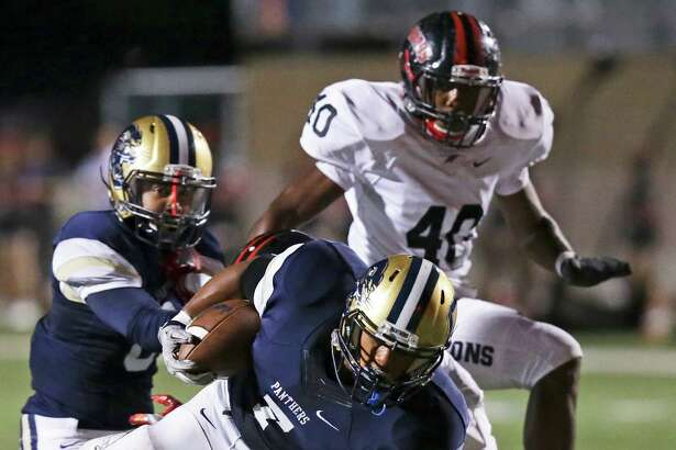 Panther running back Brandin Bradford eludes a tackle up the middle as O'Connor plays Stevens at Farris Stadium on October 13, 2016.