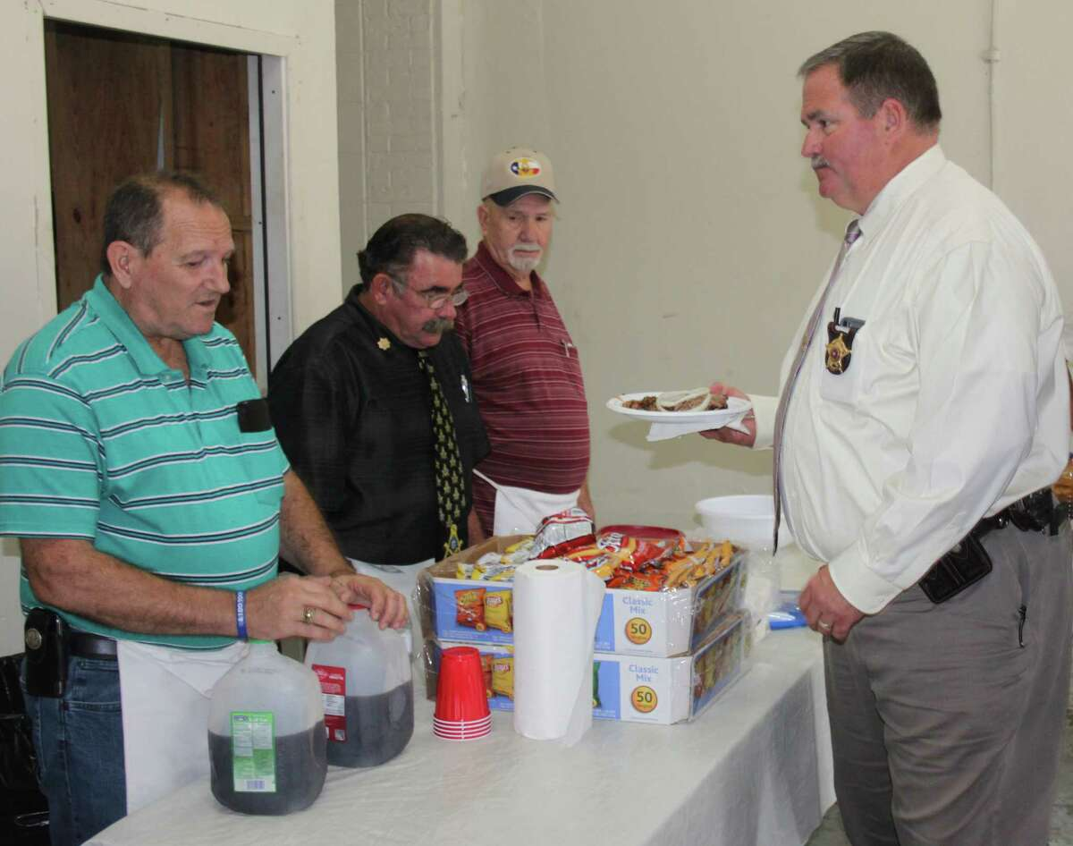 San Jacinto County Sheriff Greg Capers (right) is served a barbecue plate lunch by members of the Mt. Moriah and Shepherd Masonic Lodges.
