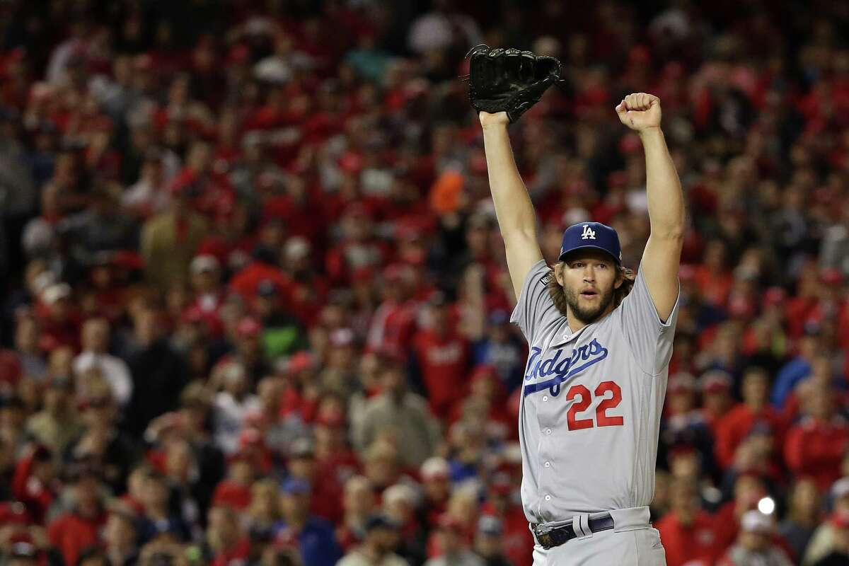 WASHINGTON, DC - OCTOBER 13: Clayton Kershaw #22 of the Los Angeles Dodgers celebrates after winning game five of the National League Division Series over the Washington Nationals 4-3 at Nationals Park on October 13, 2016 in Washington, DC.