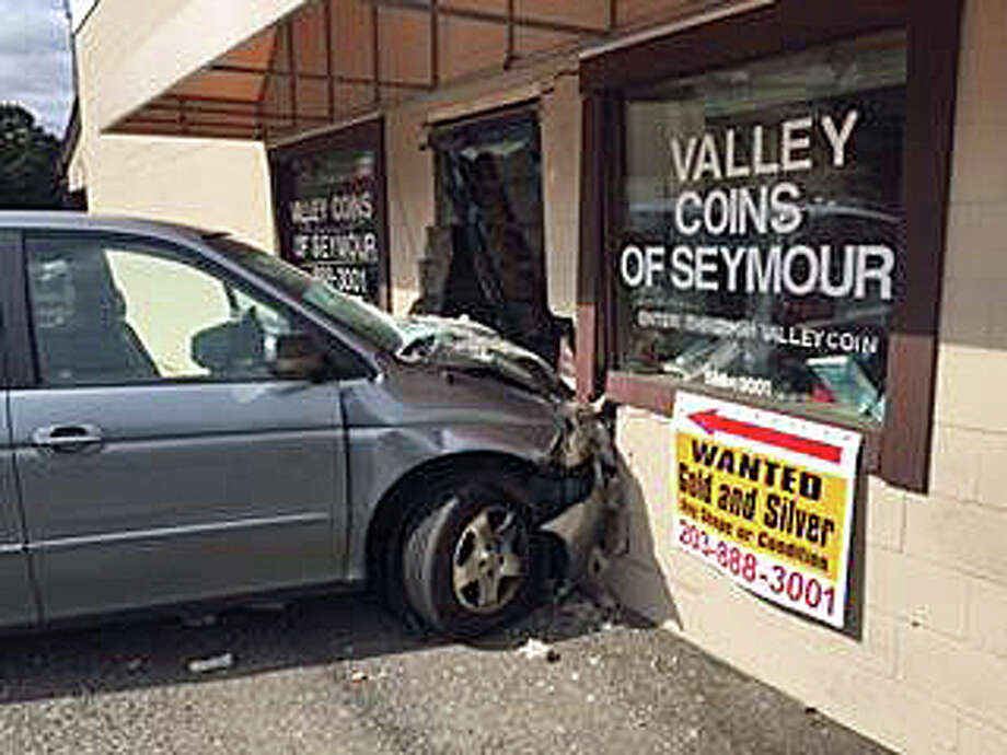 A 77-year-old Shelton woman lost control of her mini-van, sending into the Valley Coins building in Seymour on Thursday, Oct. 13, 2016. The woman, who was not identified, was taken to Waterbury Hospital for treatment. No one inside Valley Coin was hurt, but the building did have extensive damage, police said. Photo: Seymour Police Via Facebook