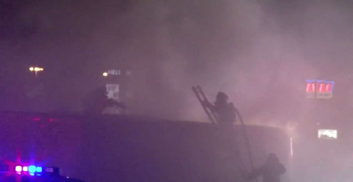 A man died and his two young sons were injured when their big rig moving van overturned and burst into flames about 1:15 a.m. Friday, Oct. 14, 2016, on the southbound North Freeway in north Houston. (Metro Video)