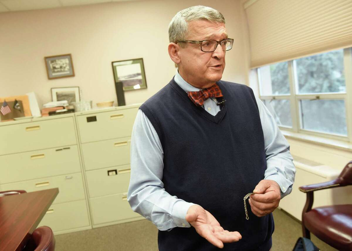 Town attorney Michael Magguilli talks about the bracelet he found that belongs to the late Charles Edward Beaudoin on Thursday, Oct. 13, 2016, at Colonie Town Hall in Latham, N.Y. (Cindy Schultz / Times Union)