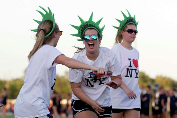 College Park volleyball player Emily Claire Ross jokes around during the school's homecoming parade at Woodforest Bank Stadium Wednesday, Oct. 12, 2016, in Shenandoah.