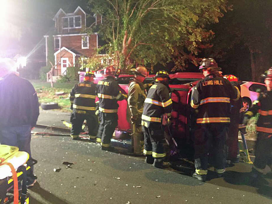 At least one person was injured on Thursday, Oct. 13, 2016 in a two-vehicle accident at the intersection of Main Street and Blackhouse Road in Trumbull.Long Hill firefighters said on their Facebook page that the rollover accident required extrication. Photo: Long Hill Fire Company Via Facebook