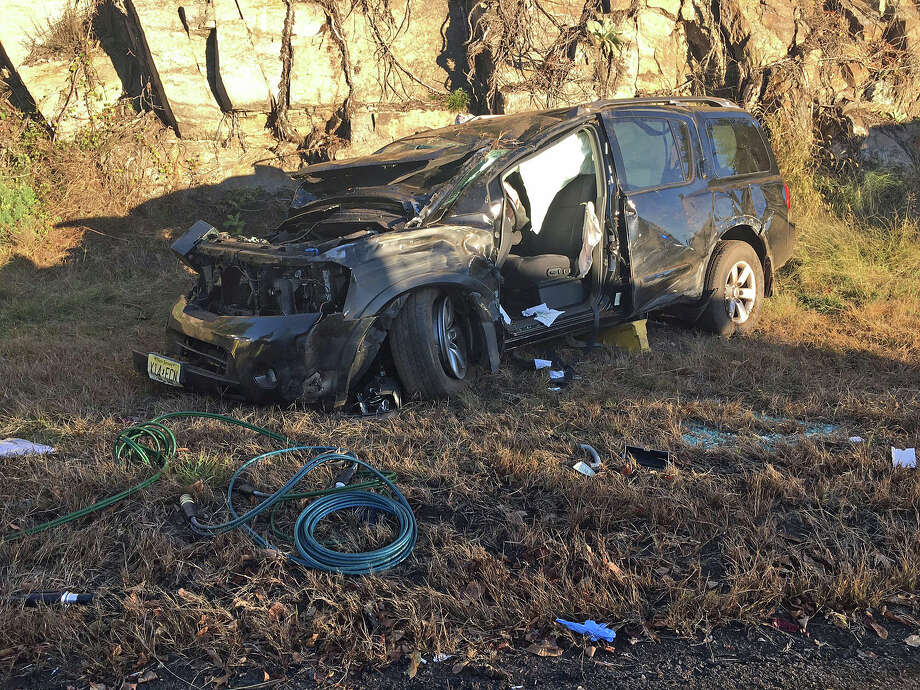 A black SUV with New Jersey license plates overturnned on southbound Route 8 around 8 a.m. on Friday, Oct 14, 2016..State Police say that the sound Route 8 crash involves non-life-threating injuries. Photo: State Police Via Twitter