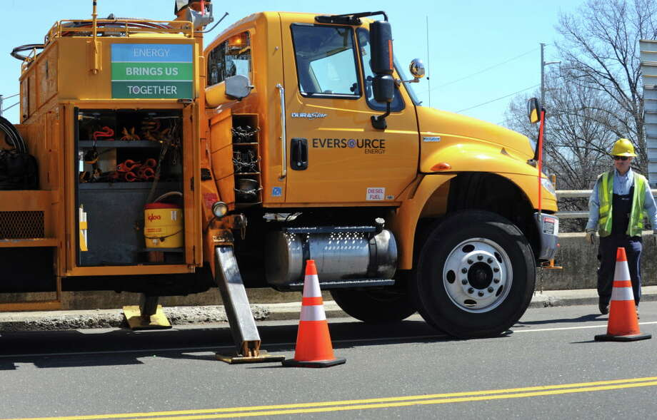 FILE — Eversource work crews on the scene at the corner of Hales Road and and Greens Farm Road in Westport, Conn. on Friday, April 15, 2016. Photo: Cathy Zuraw / Hearst Connecticut Media / Connecticut Post