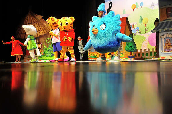 Cast members perform an opening number at the Julie Rogers Theatre Thursday night during the Daniel Tiger's Neighborhood Live! performance in Beaumont. The popular children's television show, which is based on the work of Fred Rogers, uses music and imagination to follow the life of preschooler Daniel and his friends as they learn life lessons and social skills.  Photo taken Thursday, October 13, 2016 Kim Brent/The Enterprise