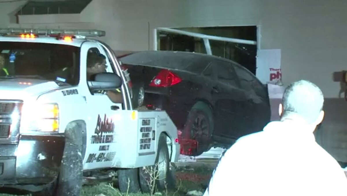 Two young men were arrested about 10 p.m. Thursday, Oct. 13, 2016, after they crashed a car into a house in Humble. A Harris County Precinct 4 deputy constable said the men were suspected of robbing an auto parts store near Aldine Westfield and Treaschwig and were trying to get away from officers. The suspects had allegedly hijacked the car earlier in the evening, deputies said. (Metro Video)