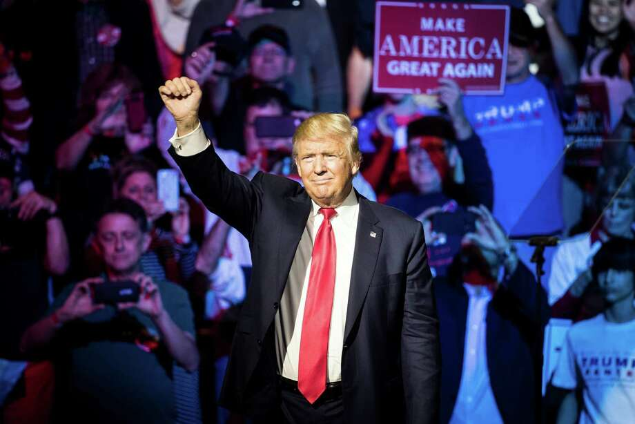 Republican presidential candidate Donald Trump waves to the crowd during a campaign rally, Thursday, Oct. 13, 2016, in Cincinnati. Photo: John Minchillo, AP / AP