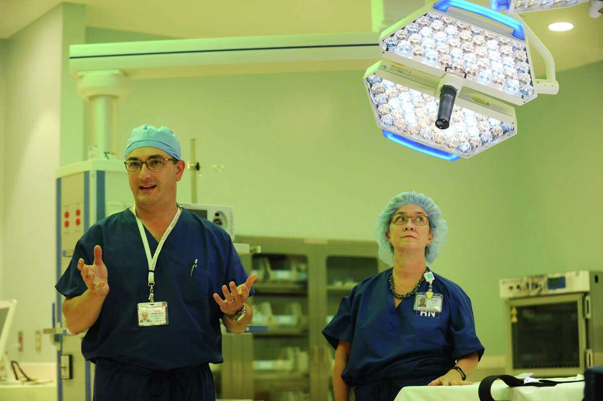 Surgeon and vice chair of the department of surgery Dr. Michael Ebright, left, and Executive Director of Perioperative Services Faith Dorio discuss the new features of the operating rooms inside the new Stamford Hospital in Stamford, Conn. on Wednesday, September 21, 2016.