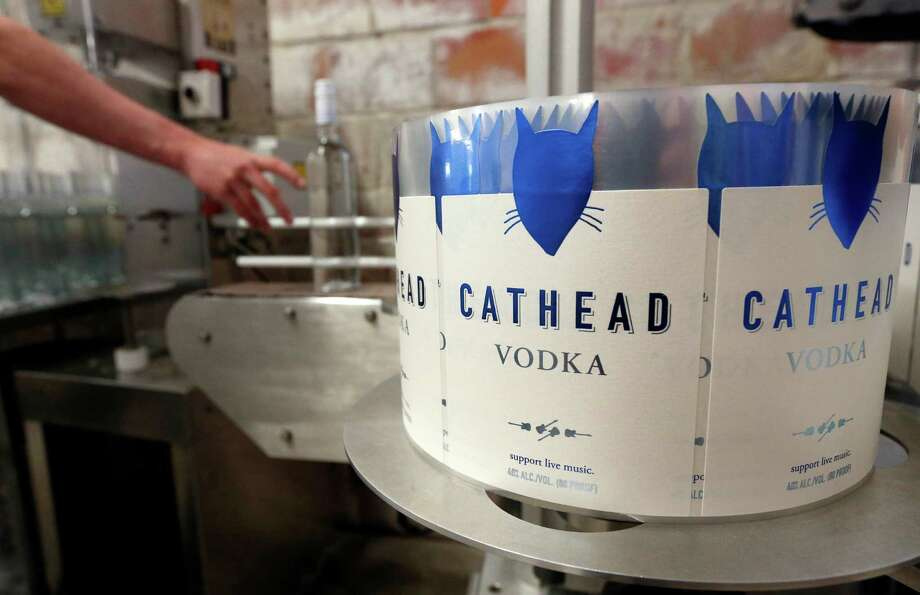 Chase Ming places a capped bottle of vodka on a conveyer belt so that it can be labeled at the Cathead Distillery in Jackson, Miss. The Labor Department said its producer price index, which measures cost pressures before they reach the consumer, increased 0.3 percent in September. Food prices at the wholesale level rose 0.5 percent. Photo: Rogelio V. Solis /Associated Press / Copyright 2016 The Associated Press. All rights reserved. This material may not be published, broadcast, rewritten or redistribu