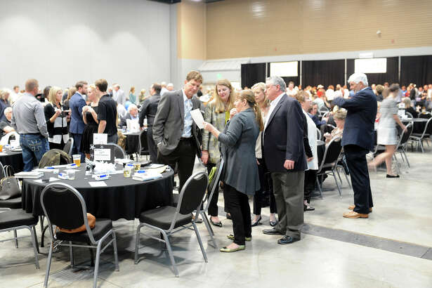 """Fundraiser attendees congregate during the Habitat For Humanity fundraiser on Thursday, Oct. 13, 2016, at Horseshoe Arena. Marcus Luttrell, former Navy SEAL and author of """"Lone Survivor,"""" was the guest speaker at the fundraiser.  James Durbin/Reporter-Telegram"""