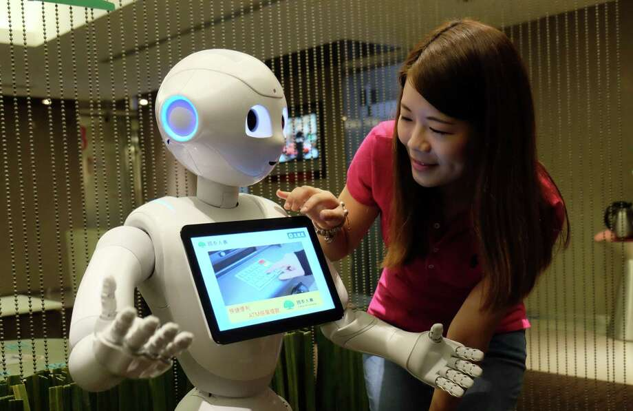 Japanese telecommunications and internet company SoftBank Group Corp. is setting up a $25 billion private fund for technology investments with the potential to grow to $100 billion. Among its tech investments is Pepper, the human-shaped companion robot for homes and businesses that SoftBank sells. Photo: Sam Yeh /AFP /Getty Images / AFP or licensors