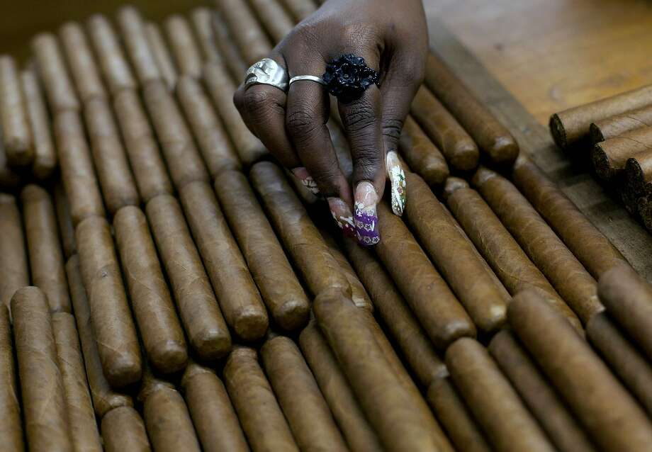 FILE - This March 1, 2013 file photo shows a worker selecting cigars at the H. Upmann cigar factory, where people can take tours as part of the 15th annual Cigar Festival in Havana, Cuba. The Obama administration announced Friday, Oct. 14, 2016 it is eliminating a $100 limit on the value of Cuban rum and cigars that American travelers can bring back from the island. (AP Photo/Ramon Espinosa, File) Photo: Ramon Espinosa, Associated Press