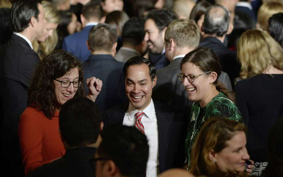U.S. Department of Housing and Urban Development Secretary Julian Castro (C) attends a reception for Hispanic Heritage Month also attended by President Barack Obama  in the East Room of the White House on October 12, 2016 in Washington, DC. Photo: Pool, Pool / Getty Images / 2016 Getty Images