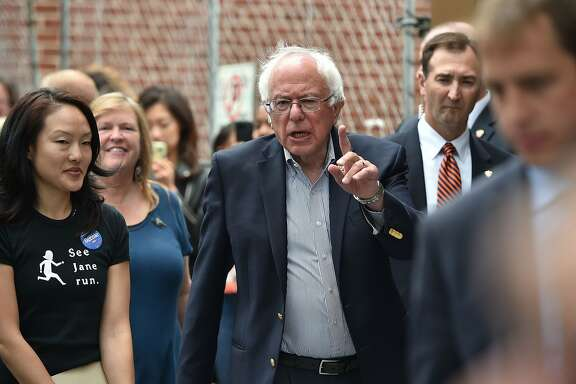 Democratic presidential candidate Bernie Sanders walks with San Francisco Supervisor Jane Kim (L) in San Francisco, California on June 7, 2016.  Democratic presidential candidate Hillary Clinton has mounted a hectic push in California, keen to finish strong and end any argument for Sanders to remain in the race. / AFP PHOTO / JOSH EDELSONJOSH EDELSON/AFP/Getty Images