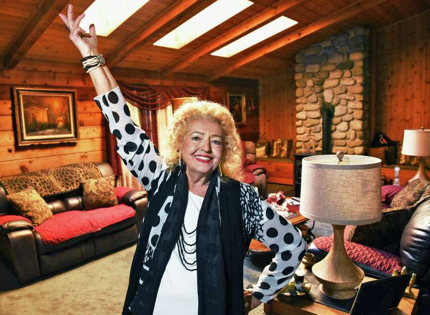 Former burlesque star April March, Velma Fern Edmiston, 81, in the living room of her log home Tuesday Oct. 11, 2016 in Wilton, NY. (John Carl D'Annibale / Times Union)