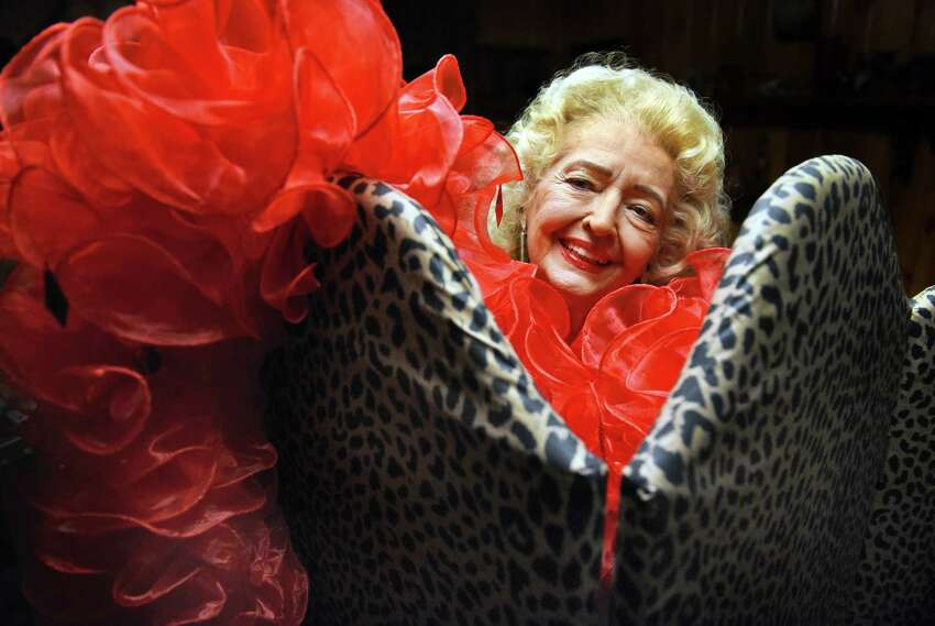 Former burlesque star April March, Velma Fern Edmiston, 81, poses with a boa during an interview at her home Tuesday Oct. 11, 2016 in Wilton, NY. (John Carl D'Annibale / Times Union)