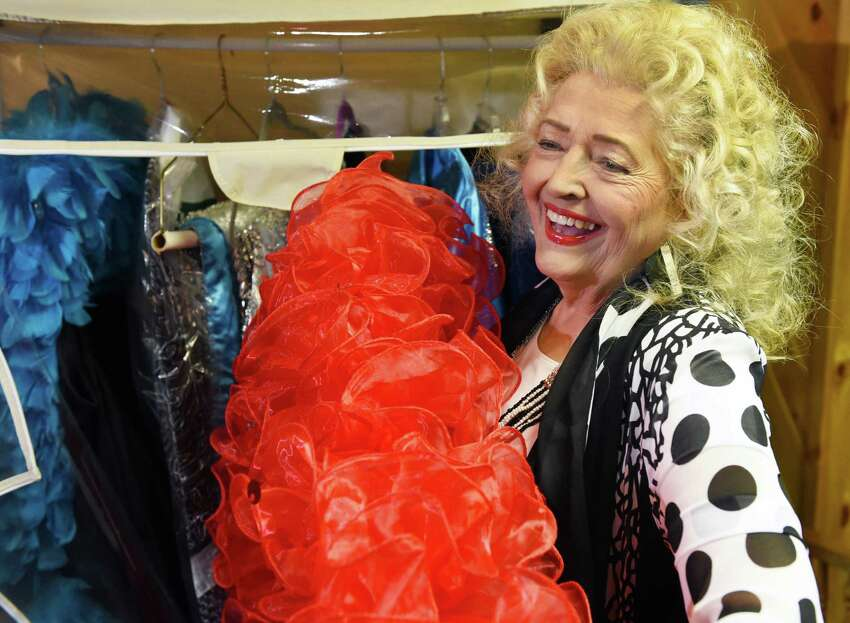 Former burlesque star April March, Velma Fern Edmiston, 81, pulls a boa from a costume closet during an interview at her home Tuesday Oct. 11, 2016 in Wilton, NY. (John Carl D'Annibale / Times Union)