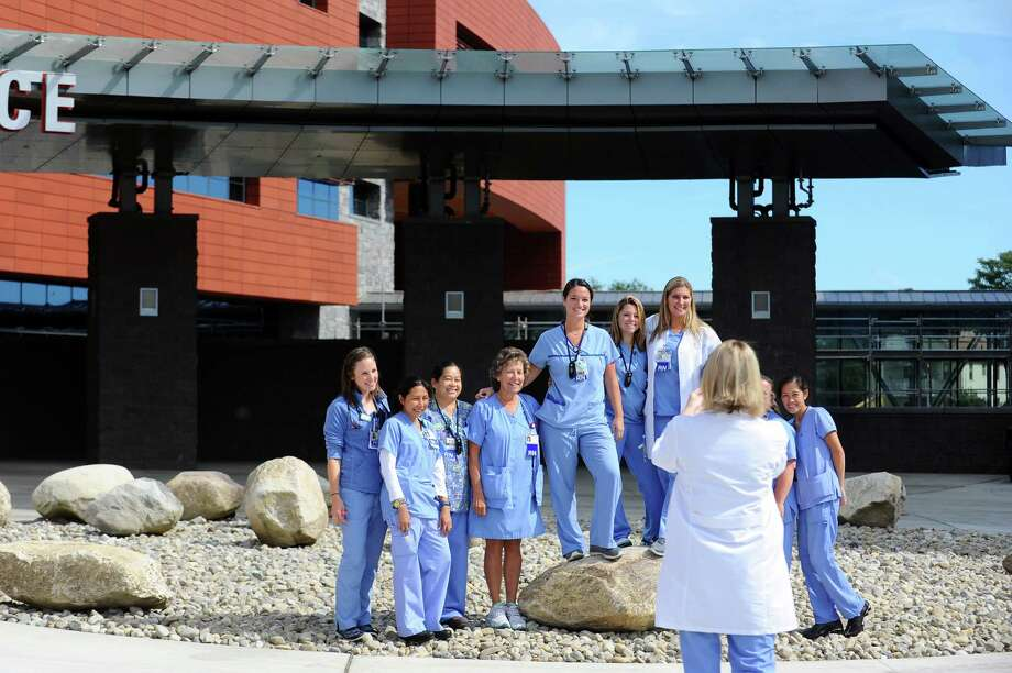Nurses take a group photo prior to the ribbon-cutting in front of the emergency bay of the new Stamford Hospital on Sept. 26. Photo: Michael Cummo / Hearst Connecticut Media / Stamford Advocate