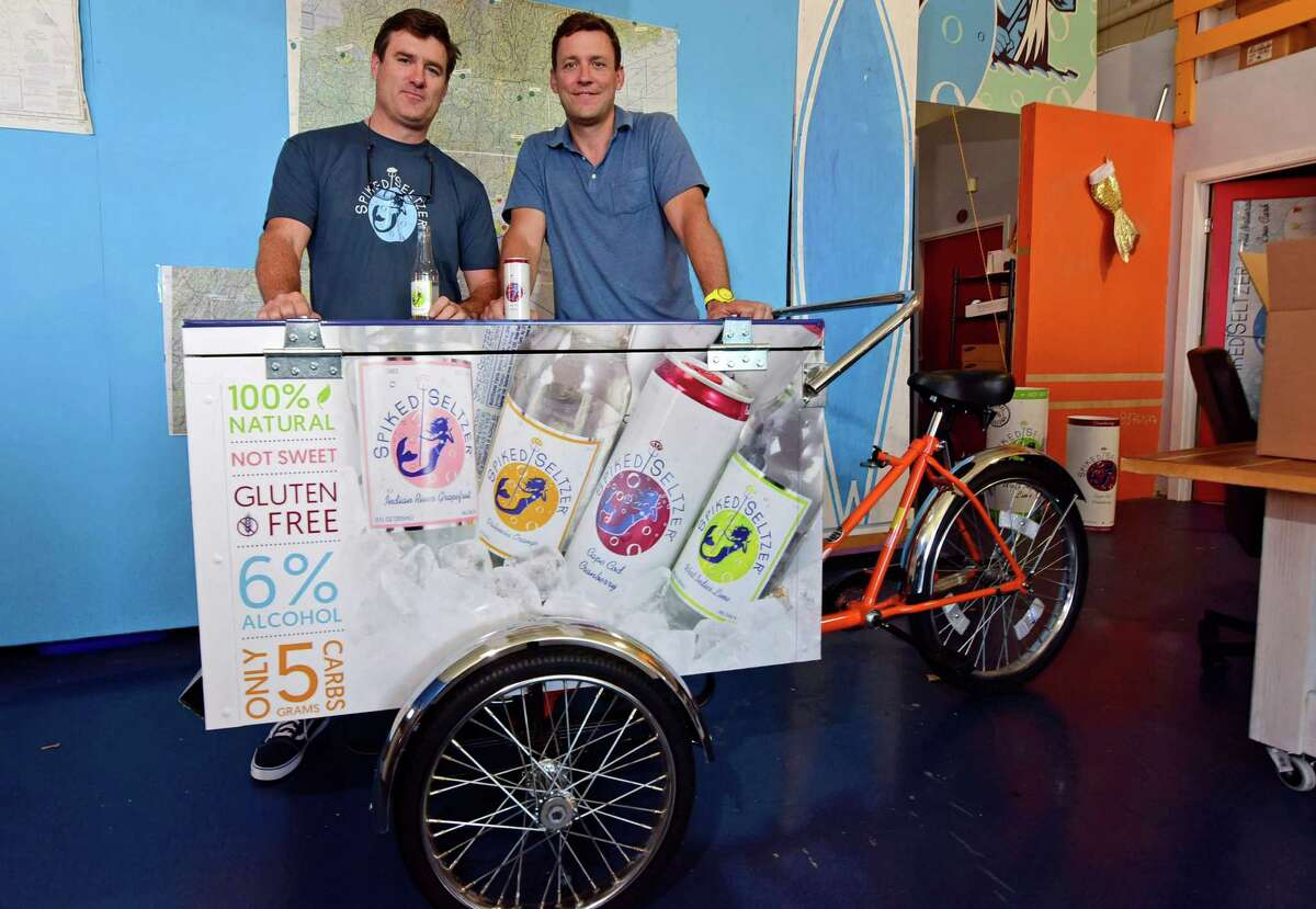 Boathouse Beverage co-founders Dave Holmes and Nick Shields in their Norwalk, Conn. office Thursday, October 6, 2016. The company celebrated their sale to Anheuser Busch-InBev in September. The start-up created the category of