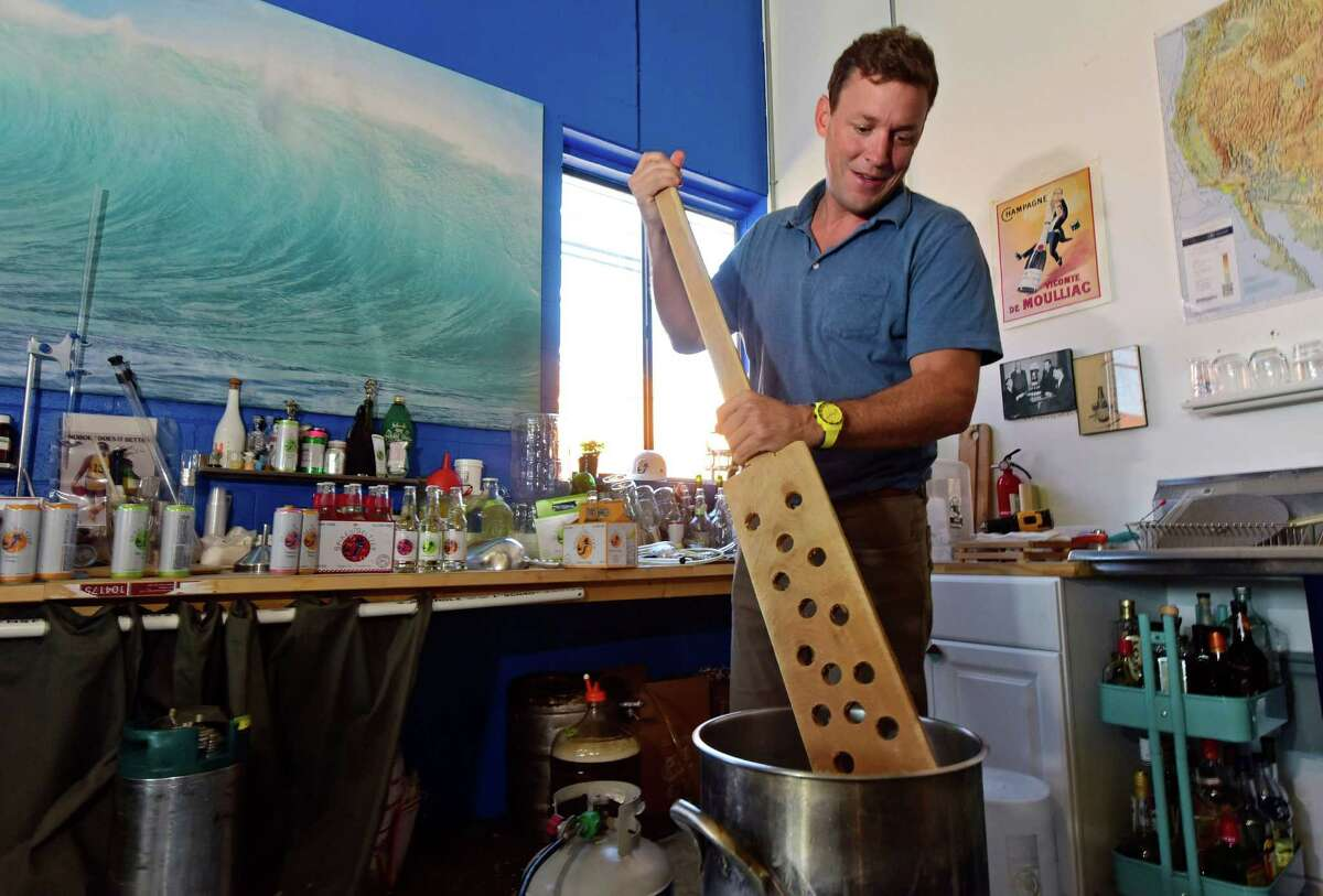 Boathouse Beverage co-founder Nick Shields tinkers with drink formulations in the company's Norwalk, Conn. office Thursday, October 6, 2016. The company celebrated their sale to Anheuser Busch-InBev in September. The start-up created the category of
