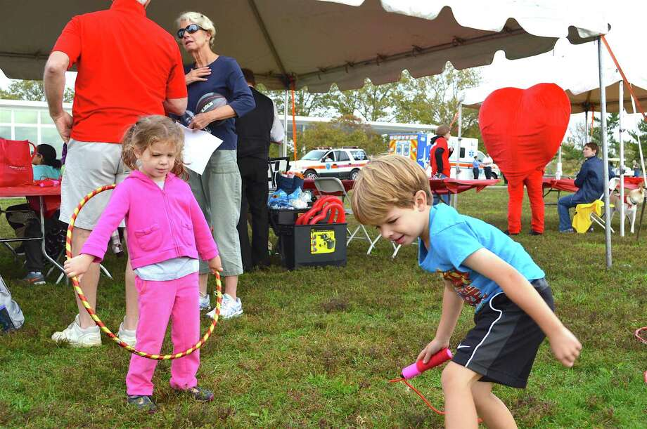 Kayla Flynn, 3, and her brother Jameson, 5, of New Canaan, entertain themselves before the walk at the 26th annual Fairfield County Heart Walk on Oct. 8, 2016, at Sherwood Island State Park in Westport, Conn. Photo: Jarret Liotta / For Hearst Connecticut Media / Westport News Freelance