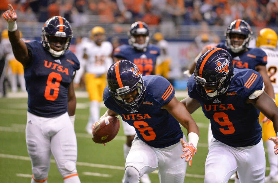 UTSA cornerback Aneas Henricks (6) celebrates a fumble recovery with teammates Michael Egwuagu (8) and Marcos Curry during the second half of a game against Arizona State, Friday, Sept. 16, 2016, in San Antonio. Arizona State won 32-28. Photo: Darren Abate /Associated Press