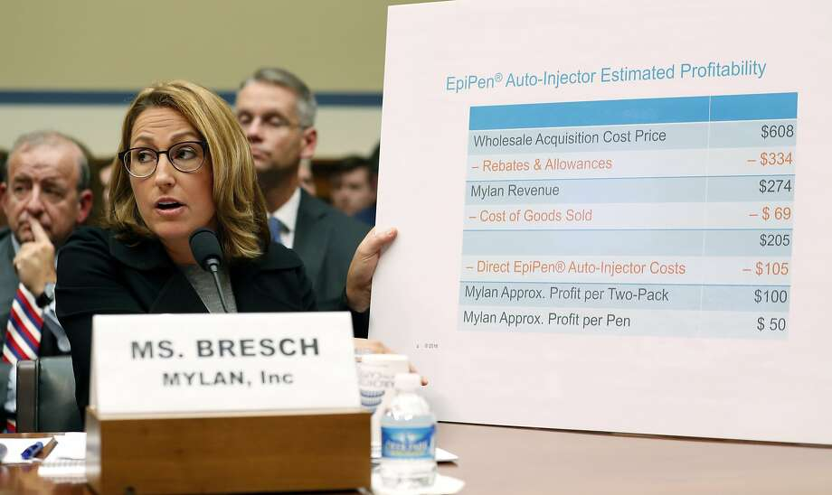 Mylan CEO Heather Bresch defends the cost of EpiPens on Capitol Hill in September. This summer, Mylan began offering $300 coupons to patients whose health insurance included a deductible or co-payment. Photo: Alex Brandon, Associated Press